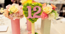Pink and Green Floral Centerpiece with Cut-Out Table Numbers