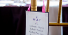 Table Number And Names Hang From Chair at Wedding Reception