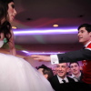 Bride and Groom lifted up on chairs in dance at Wedding